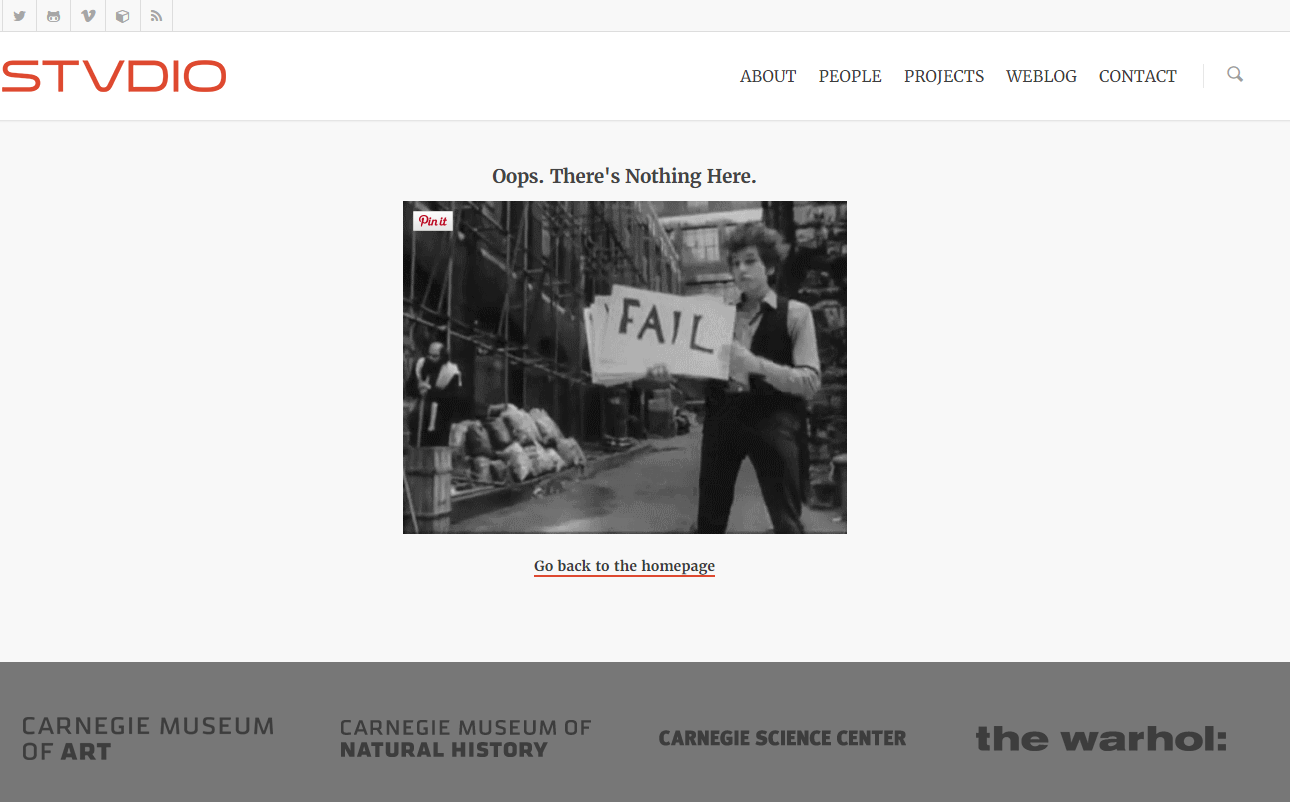 """Animated GIF of Bob Dylan with signs that say """"FAIL"""""""